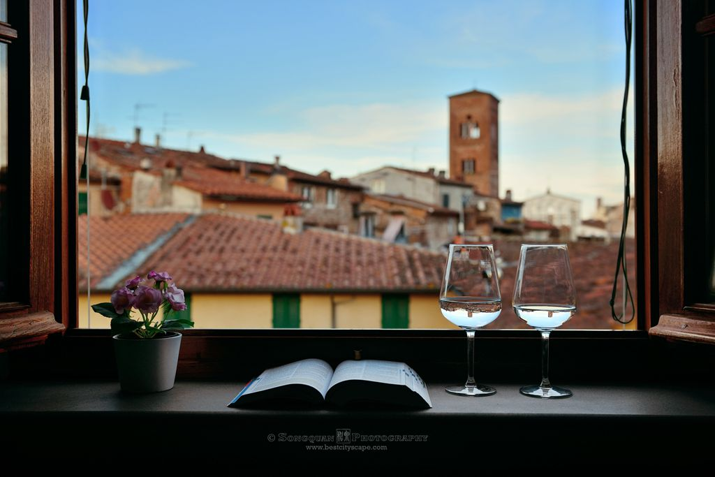 Lucca, a lazy afternoon. Old buildings from our room window. Preview photo from my Italy trip.
