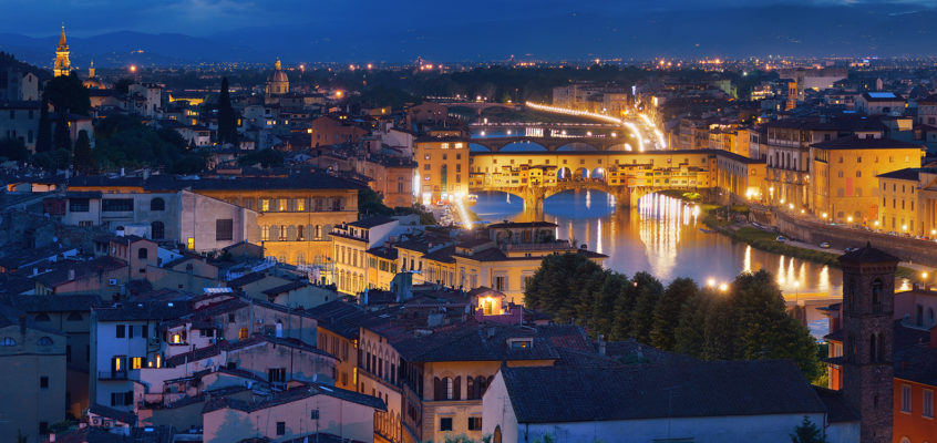 Florence dusk after sunset with the city lights on