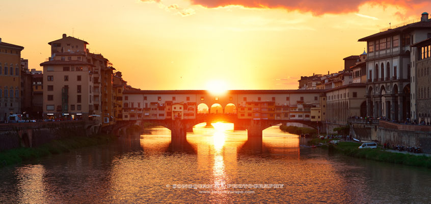 Florence sunset panorama over Ponte Vecchio and Arno River.