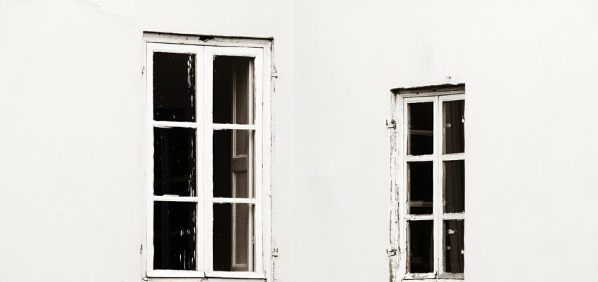 Windows of historic buildings in Lucca Italy